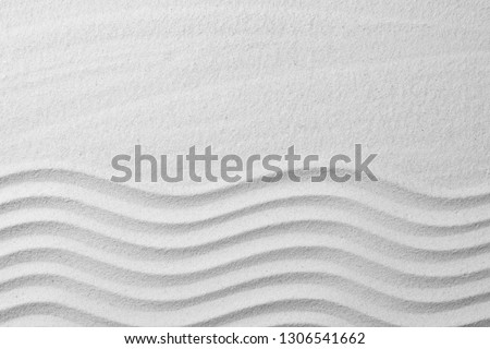 Zen garden pattern on sand as background, top view with space for text. Meditation and harmony