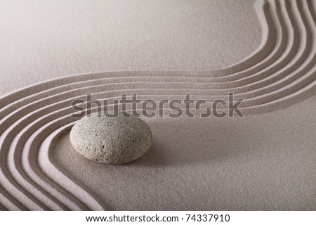 zen garden with raked sand and round stone pattern of ripples and lines create tranquil scene ideal for relaxation and meditation