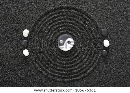 zen garden with stone of yin and yang