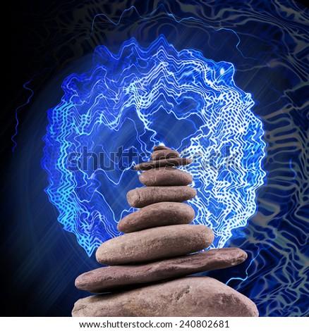 Zen like balanced and electrified stone tower.
