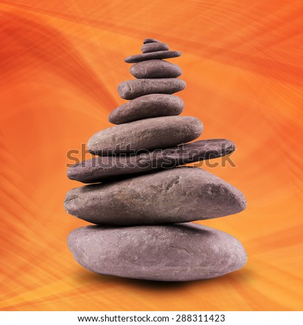 Zen like, balanced stone tower with a background.