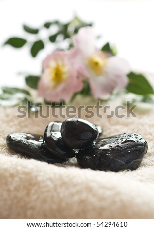 Zen like spa with wet black stones