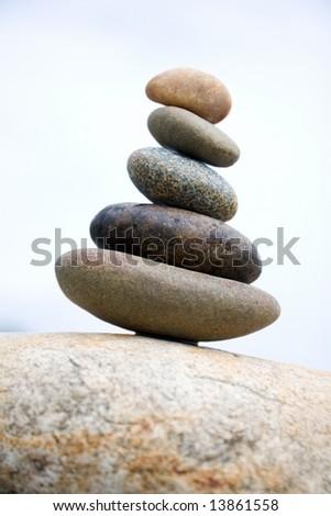 Zen like stones stack on the big stone