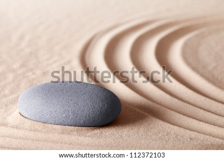 zen meditation stone conceptual Japanese garden referring to balance harmony simplicity tranquility for relaxation and spirituality background