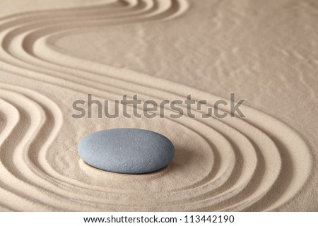 Zen meditation stone traditional Japanese garden with sand and rock pattern concept for simplicity harmony and serenity helps in concentration and relaxation