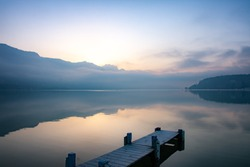 zen moment by the lake of annecy at sunrise