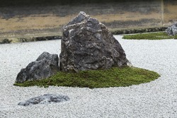 Zen Rock Garden in Ryoan-ji Temple.In a garden fifteen stones on white gravel, Kyoto, Japan