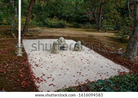 Zen rock garden with raked gravel. relaxing and calming Japanese garden. Nice place for meditation