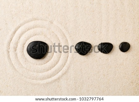 Zen sand and stone garden with raked circles. Simplicity, concentration or calmness abstract concept. Top view.