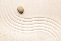 Zen sand and stone garden with raked curved lines. Simplicity, concentration or calmness abstract concept. Top view.