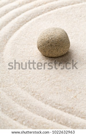 Zen sand and stone garden with raked curved lines with selective focus. Simplicity, concentration or calmness abstract concept