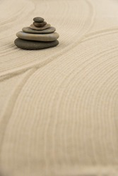 Zen sand garden meditation stone background with copy space. Stones and lines drawing in sand for relaxation. Concept of harmony, balance and meditation, spa, massage, relax. Set Sail Champagne color