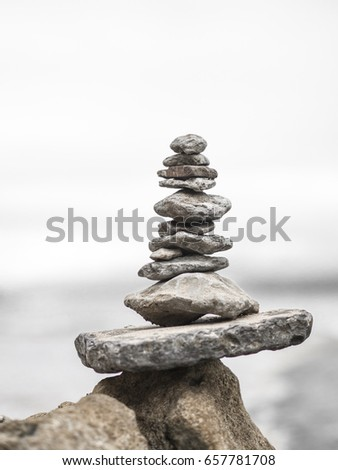 zen stone. Stones in balance in a quiet composition with the background beach that inspires and invites well-being #657781708