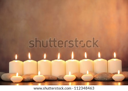 Zen stones and aromatic candles on table,Zen concept. - stock photo