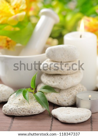zen  stones and plants on the wooden mat