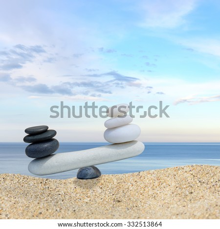 Zen stones balance concept.The balance between black and white #332513864