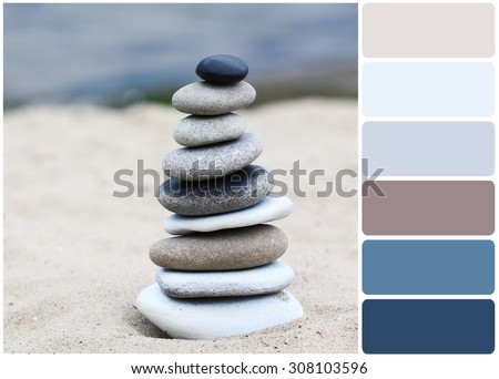 Zen stones balance spa on beach and palette of colors
