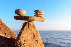 Zen stones in balance at seashore