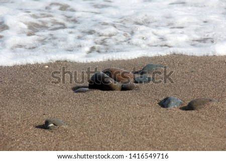 Zen stones on a pebble beach. Relaxation and tranquility atmosphere #1416549716