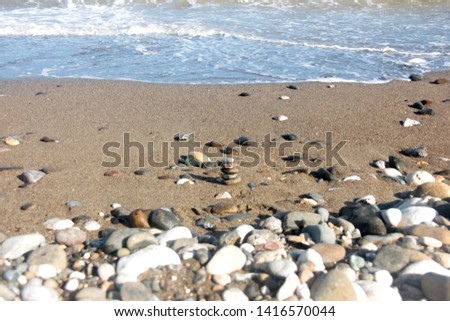 Zen stones on a pebble beach. Relaxation and tranquility atmosphere #1416570044