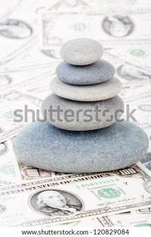 Zen stones on money, dollars
