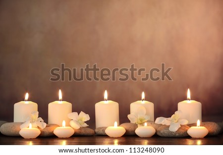 Zen stones,orchid flower and aromatic candles on table,Zen concept. - stock photo