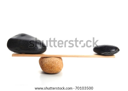 zen stones scales isolated on white showing weight or spa concept with copyspace - stock photo