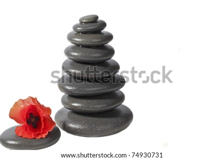 Zen stones with red poppy flower on a white background - stock photo