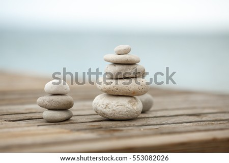 Zen Stones / Zen stone on beach for perfect meditation. Calm zen meditate background with rock pyramid on sand