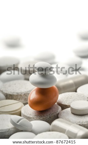 zen-style pills isolated on white