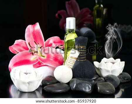 zen. thai oil massage accessories. spa and wellness concept. candles, lily flower and stones