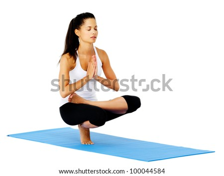 Zen yoga woman in mountain pose relaxed and calm. This is part of a series of various yoga poses by this model, isolated on white