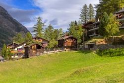 Zermatt, alpine village, Switzerland, Swiss Alps colorful autumn panorama, houses and trees