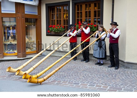ZERMATT, SWITZERLAND - AUGUST 14: Swiss musicians play in Zermatt streets on August 14, 2011 during the 2011 Folklore Summer Festival where more than 50 groups and 1200 Swiss dancers took part.