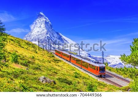 Zermatt, Switzerland. Gornergrat tourist train with Matterhorn mountain in the background. Valais region.
