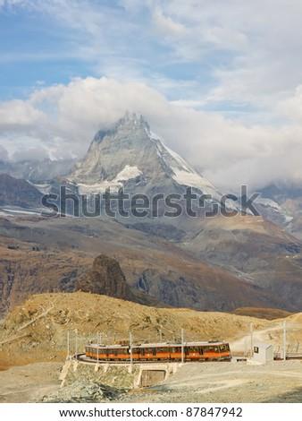 ZERMATT, SWITZERLAND - SEP 17: The Gornergratbahn, a narrow gauge mountain rack railway, approaches the Gornergrat summit station on Sep 17, 20111, near Zermatt, Switzerland. - stock photo