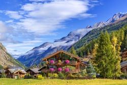 Zermatt, Switzerland, Swiss Alps alpine village, mountain peaks panorama, houses decorated with flowers