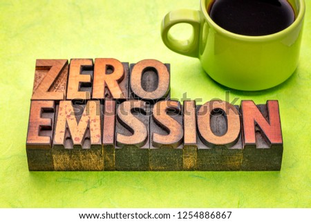 zero emission - word abstract in vintage letterpress wood type with a cup of coffee
