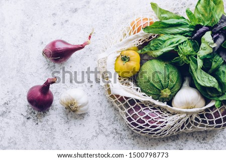 Zero waste cconcept. Package-free food shopping. Eco friendly natural bag with organic fruits and vegetables. Sustainable lifestyle concept. Plastic free items. Reuse, reduce, refuse. Top view.