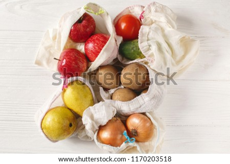 zero waste food shopping. eco natural bags with fruits and vegetables, eco friendly, flat lay. sustainable lifestyle concept.  plastic free items. reuse, reduce, recycle, refuse. groceries in eco bags