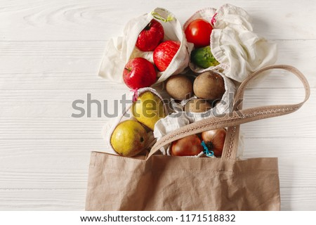zero waste food shopping. eco natural bags with fruits and vegetables in tote, eco friendly, flat lay. sustainable lifestyle concept. plastic free items. reuse, reduce, recycle, refuse. #1171518832