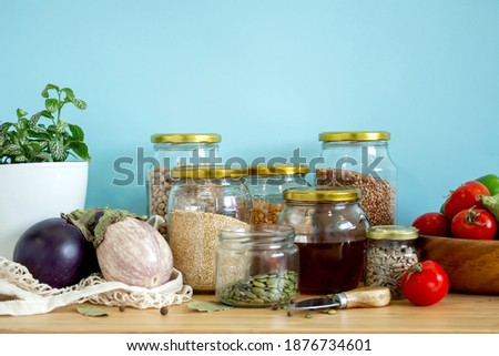 Zero waste healthy food-cereals, seeds, vegetables flat lay on grey background. Groceries in textile bags,glass jars, wooden bowl. Eco friendly plastic free low waste lifestyle. Photo stock ©