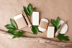 Zero waste natural cosmetics products on craft paper table. Flat lay, organic solid soap and shampoo bars, antibacterial handcrafted soap concept, mock up, organic detail, fern brunches