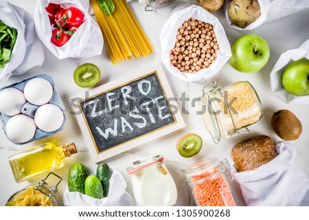 Zero waste shopping and sustanable lifestyle concept, various farm organic vegetables, grains, pasta, eggs and fruits in reusable packaging supermarket bags. copy space top view, white concrete table #1305900268