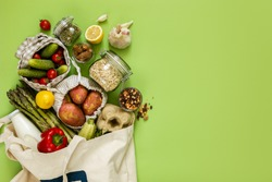 Zero waste shopping concept - groceries in textile bags and glass jars, top view