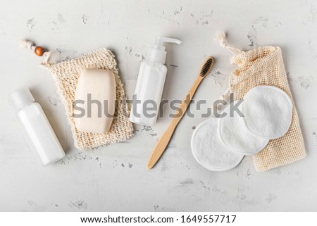 Zero waste, sustainable bathroom and lifestyle. Bamboo toothbrush, natural soap, cotton make-up removal pads, homemade DIY beauty products in reusable bottles.
