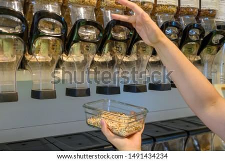 Zero Waste, woman buys food in an unpacked shop