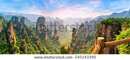 Zhangjiajie Forest Park. Panoramic view above the cliffs and mountains to the colorful valley at sunrise. Picturesque landscape. Majestic nature.