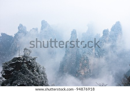 zhangjiajie national park in winter with snow and fog,Hunan China