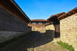 ZHERAVNA, BULGARIA, EUROPE, NOVEMBER 2019. Zheravna Ethnographic Reserve. Traditional Bulgarian village of historical wooden houses from the 19th century. Wood and stone prevail.